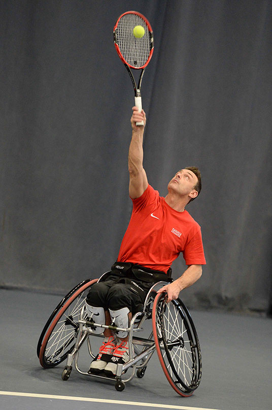 Wheelchair tennis player Tony Knappett in action